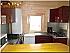 Keuken volledig uitgerust, boiler, koelkast, magnetron, fornuis.
